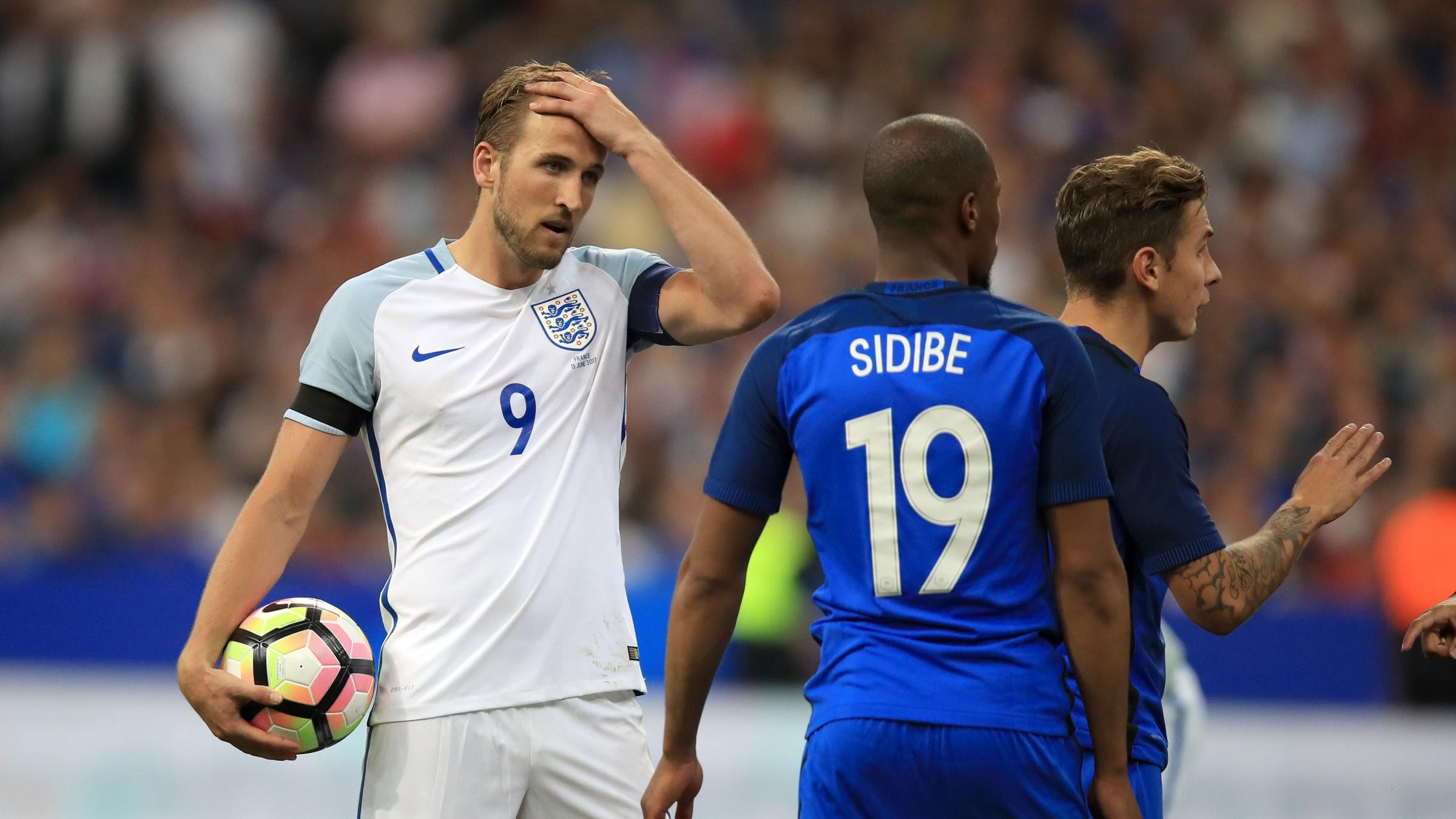 England lose to 10-man France despite Harry Kane double